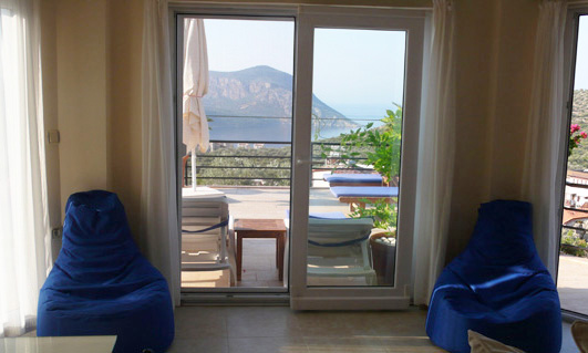 Relax on beanbags in living room, with wonderful sea views