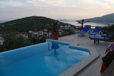 Sunset from pool terrace across to Kalamar bay