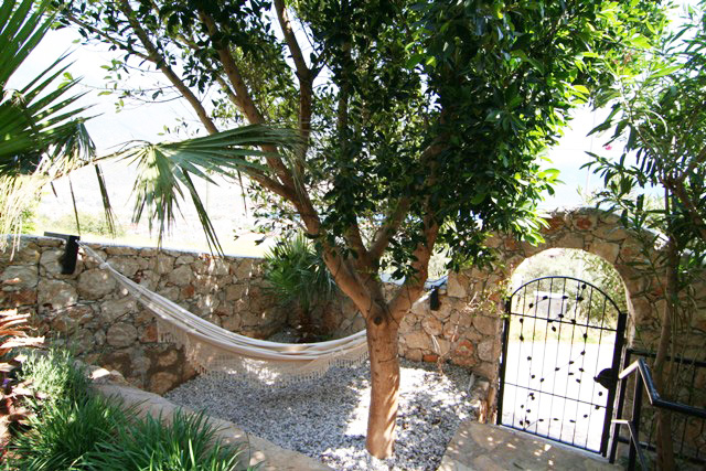Relax in large private hammock in the shade, with sea views