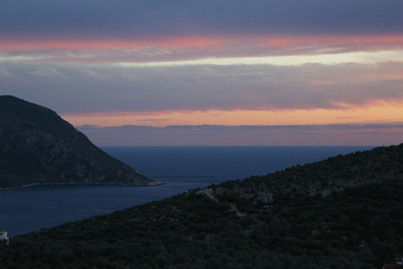 View of Kalamar Bay at dusk from the pool terrace of Kalkan holiday villa