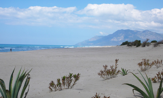 Beautiful soft sand, blue seas and mountains in background at Patara beach
