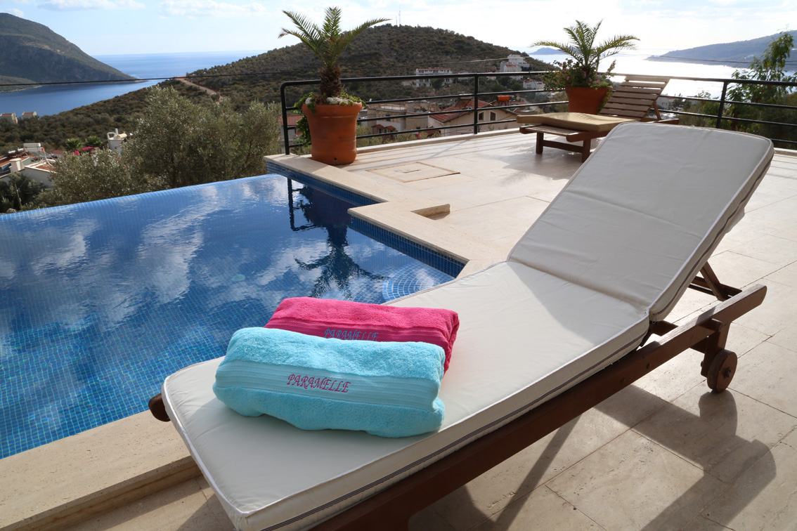 Pool towels and sunlounger by private pool