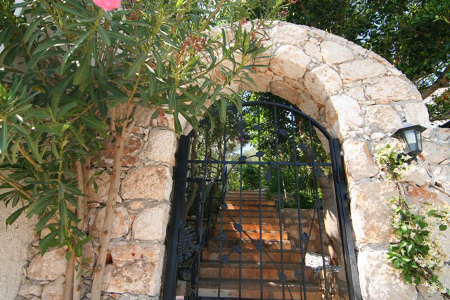 Stone arch private entrace to villa