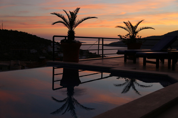 Infinity pool and terrace with Kalamar Bay beyond